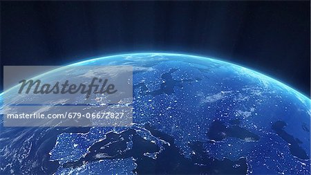 Europe at night. Computer artwork of the Earth from space with lights glowing in urban areas. Stock Photo - Premium Royalty-Free, Image code: 679-06672827