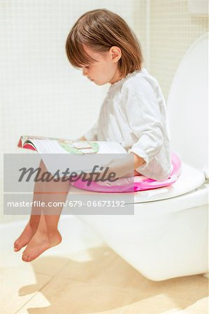 Toddler reading on the toilet. Stock Photo - Premium Royalty-Free, Image code: 679-06673192