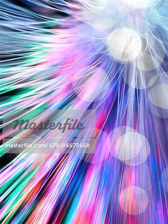 Optical fibres emitting light. Optical fibres are used in telecommunications to transmit data at high speed. Stock Photo - Premium Royalty-Free, Image code: 679-06673658