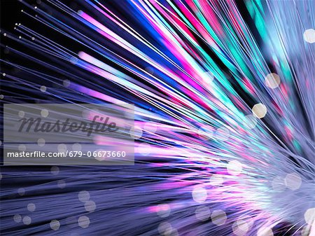 Optical fibres emitting light. Optical fibres are used in telecommunications to transmit data at high speed. Stock Photo - Premium Royalty-Free, Image code: 679-06673660