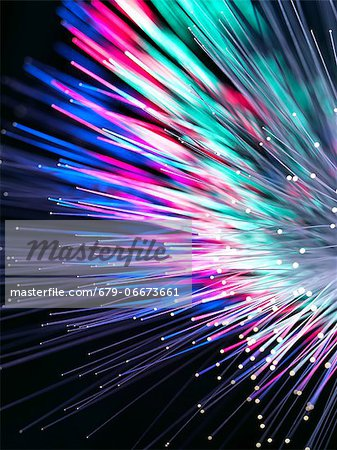 Optical fibres emitting light. Optical fibres are used in telecommunications to transmit data at high speed. Stock Photo - Premium Royalty-Free, Image code: 679-06673661
