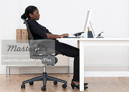 Incorrect seated posture. Stock Photo - Premium Royalty-Free, Image code: 679-06673769