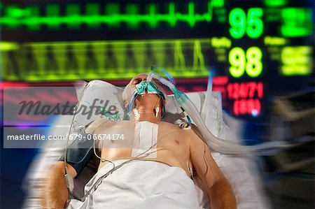 Intensive care patient. Stock Photo - Premium Royalty-Free, Image code: 679-06674174