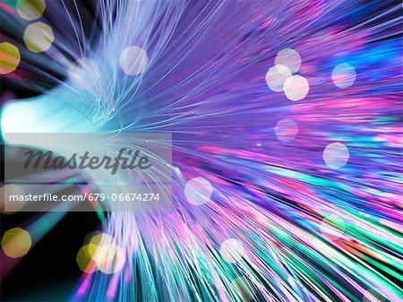 Optical fibres emitting light. Optical fibres are used in telecommunications to transmit data at high speed. Stock Photo - Premium Royalty-Free, Image code: 679-06674274