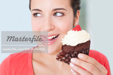 Woman with a cup cake. Stock Photo - Premium Royalty-Free, Image code: 679-06754695