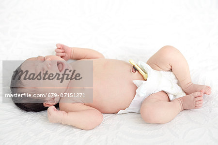 26 day old baby girl. Stock Photo - Premium Royalty-Free, Image code: 679-07151271