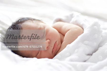 26 day old baby girl. Stock Photo - Premium Royalty-Free, Image code: 679-07151274