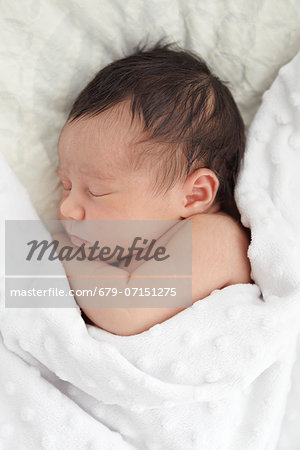 26 day old baby girl. Stock Photo - Premium Royalty-Free, Image code: 679-07151275