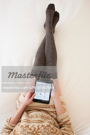 Woman using tablet computer. Stock Photo - Premium Royalty-Free, Image code: 679-07607648