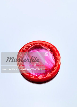 Red condom, studio shot. Stock Photo - Premium Royalty-Free, Image code: 679-07607946