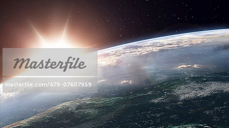 Artwork of a sun over planet earth. Stock Photo - Premium Royalty-Free, Image code: 679-07607959
