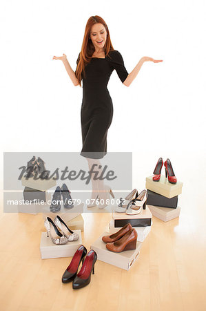 Woman with boxes of new shoes. Stock Photo - Premium Royalty-Free, Image code: 679-07608002
