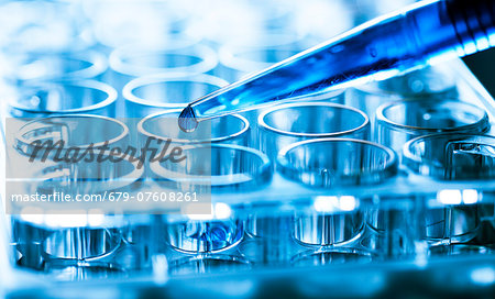 Pipette and drop of liquid with microtubes. Stock Photo - Premium Royalty-Free, Image code: 679-07608261