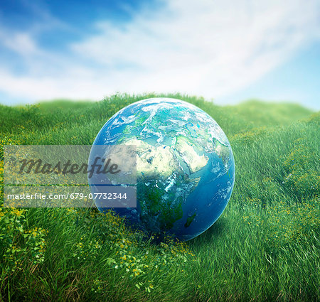 Planet earth on green grass, computer artwork. Stock Photo - Premium Royalty-Free, Image code: 679-07732344