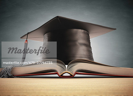 Graduation certificate and mortar board, computer artwork. Stock Photo - Premium Royalty-Free, Image code: 679-07764735