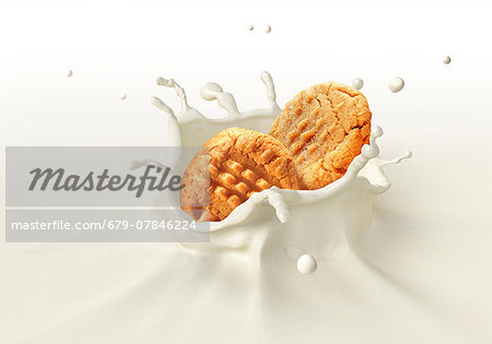 Biscuits splashing into milk, computer artwork. Stock Photo - Premium Royalty-Free, Image code: 679-07846224