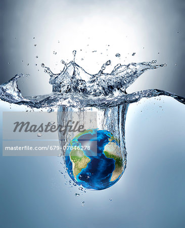Planet earth splashing into water, computer artwork. Stock Photo - Premium Royalty-Free, Image code: 679-07846278