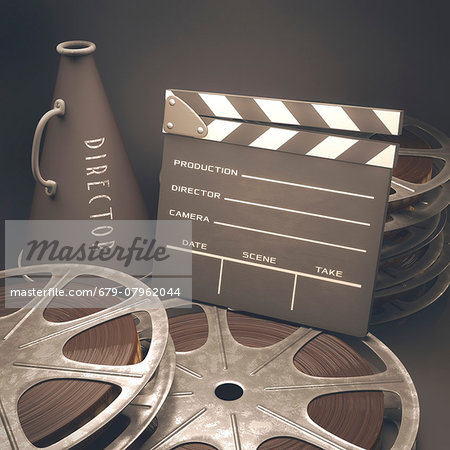 Old fashioned movie reel, megaphone and clapperboard, computer illustration. Stock Photo - Premium Royalty-Free, Image code: 679-07962044