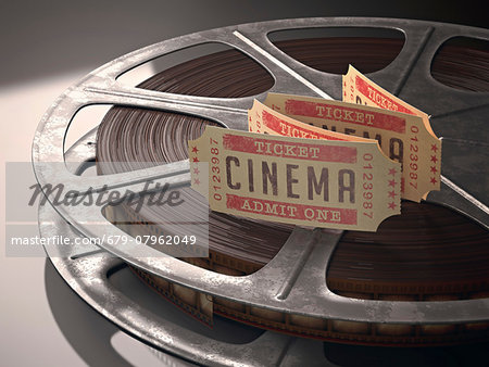 Cinema tickets and a movie reel, computer illustration. Stock Photo - Premium Royalty-Free, Image code: 679-07962049