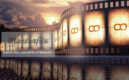 Old fashioned movie reel at sunset, conceptual illustration. Stock Photo - Premium Royalty-Free, Image code: 679-07962055