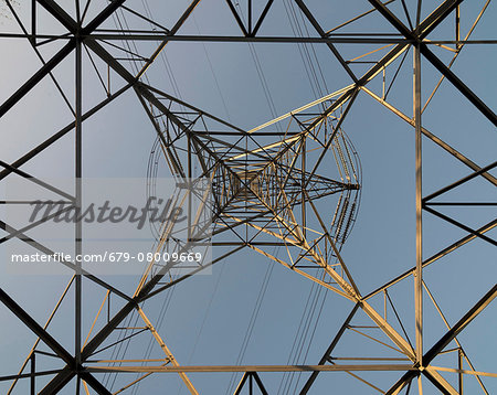 View of electricity pylon and power lines looking vertically upwards from ground level. Photographed in Wednesbury, West Midlands, UK Stock Photo - Premium Royalty-Free, Image code: 679-08009669