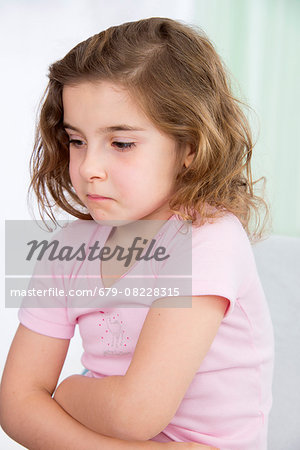 MODEL RELEASED. Young girl with her arms crossed. Stock Photo - Premium Royalty-Free, Image code: 679-08228315