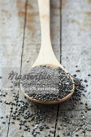 Black Chia seeds. Pile of seeds from the chia (Salvia hispanica) plant. Chia is grown commercially for its edible seeds, which are rich in omega-3 fatty acids and are traditionally eaten in Mexico, and the southwestern United States. Stock Photo - Premium Royalty-Free, Image code: 679-08426008