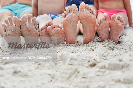 Family sitting on the beach, focus on bare feet. Stock Photo - Premium Royalty-Free, Image code: 679-08663774
