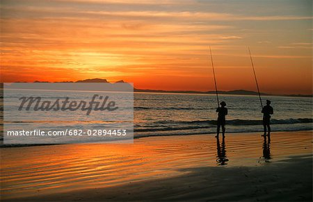 Two Fisherman at Dawn Stock Photo - Premium Royalty-Free, Image code: 682-02894453