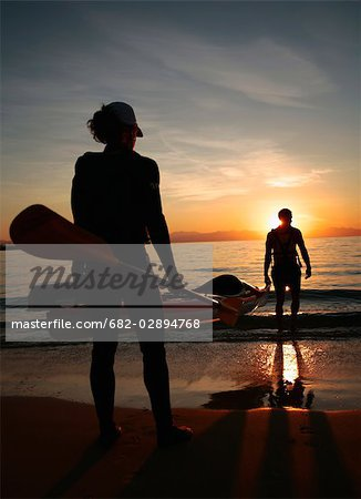 Silhouette of a Woman Holding an Oar at Sunset Stock Photo - Premium Royalty-Free, Image code: 682-02894768
