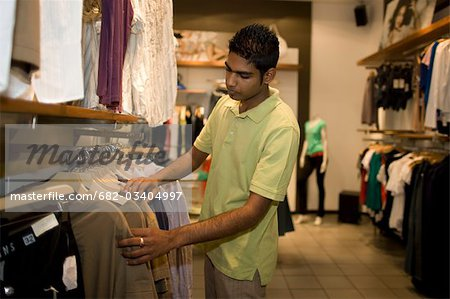 Man looking at clothes, KwaZulu Natal Province, South Africa
