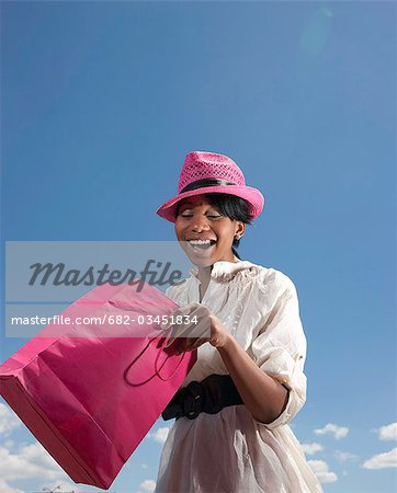 Low angle view of modern woman with shopping bags, KwaZulu Natal Province, South Africa Stock Photo - Premium Royalty-Free, Image code: 682-03451834