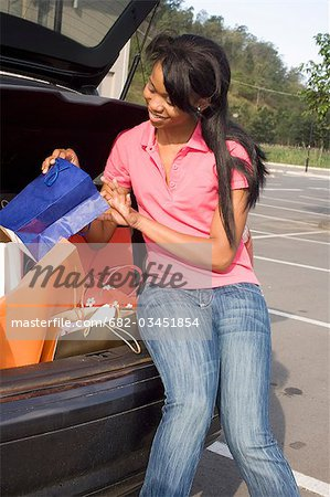 Woman loading car with shopping bags, KwaZulu Natal Province, South Africa Stock Photo - Premium Royalty-Free, Image code: 682-03451854