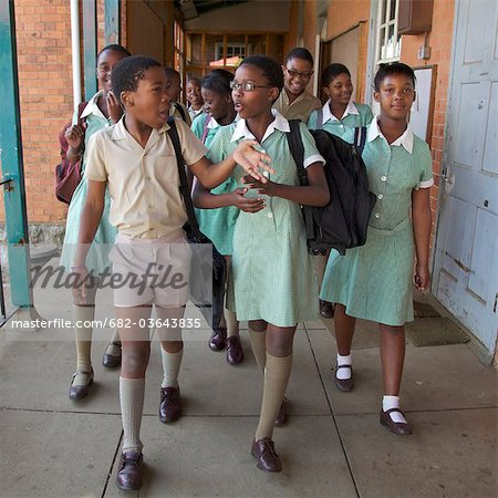 Group of schoolchildren walk together along the corridor, KwaZulu Natal Province, South Africa Stock Photo - Premium Royalty-Free, Image code: 682-03643835