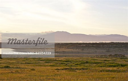 View across Lake Ndutu to Mount Lemagrut, Serengeti, Tanzania Stock Photo - Premium Royalty-Free, Image code: 682-03734729