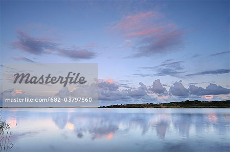 Reflected clouds in shoreline estuary system, St Lucia, Kwazulu-Natal, South Africa Stock Photo - Premium Royalty-Free, Image code: 682-03797860