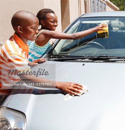 Young boy and girl cleaning car, Johannesburg, South Africa Stock Photo - Premium Royalty-Free, Image code: 682-03797951