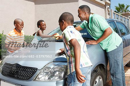 Family cleaning car, Johannesburg, South Africa Stock Photo - Premium Royalty-Free, Image code: 682-03797952