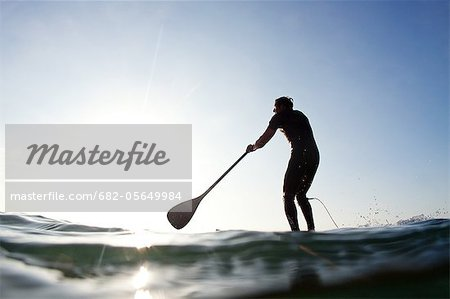 Stand-up paddle boarder paddling on sea, Durban, KwaZulu-Natal Province, South Africa Stock Photo - Premium Royalty-Free, Image code: 682-05649984