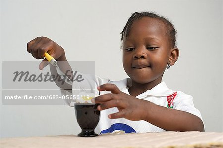 Young Kenyan girl eating boiled egg, Nairobi, Kenya Stock Photo - Premium Royalty-Free, Image code: 682-05650119