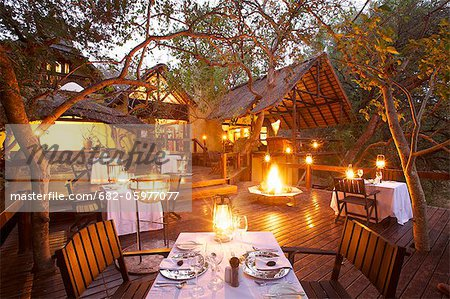 An outdoor dinning area, Pondoro Game Lodge, Balule Private Nature Reserve, Limpopo. South Africa Stock Photo - Premium Royalty-Free, Image code: 682-05977077