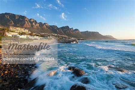 The Twelve Apostles, an extention of the Table Mountain range overlooks the white sandy beaches of camps Bay, Cape Town, Western Cape, South Africa Stock Photo - Premium Royalty-Free, Image code: 682-06373948