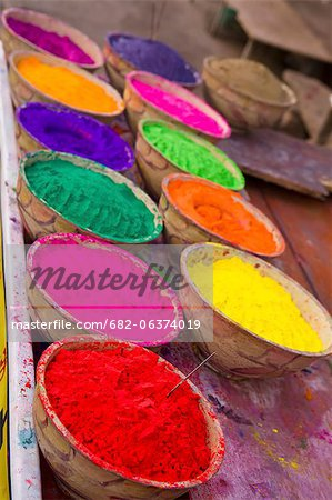 Collection of bright coloured powders for use in the making of Bindi's, taken at stall in Pushkar, Rajasthan, India Stock Photo - Premium Royalty-Free, Image code: 682-06374019