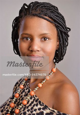 Portrait of a young African woman wearing beads, Observatory, Cape Town Stock Photo - Premium Royalty-Free, Image code: 682-06374070