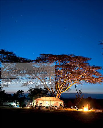 Camping at dusk, Laikipia, Kenya Stock Photo - Premium Royalty-Free, Image code: 682-06374154