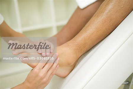 Foot massage Stock Photo - Premium Royalty-Free, Image code: 685-03081855