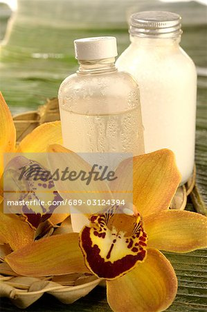 Facial toner with orchid blossom Stock Photo - Premium Royalty-Free, Image code: 689-03124394