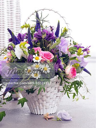 Basket with roses,vetches,veronica,chamomille and columbines Stock Photo - Premium Royalty-Free, Image code: 689-03124912