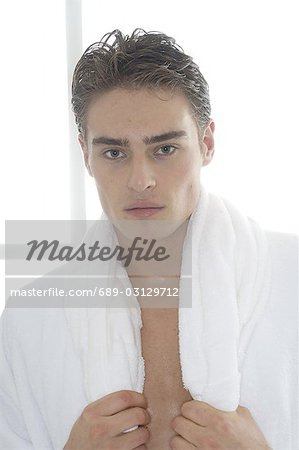 young man after hair washing Stock Photo - Premium Royalty-Free, Image code: 689-03129712