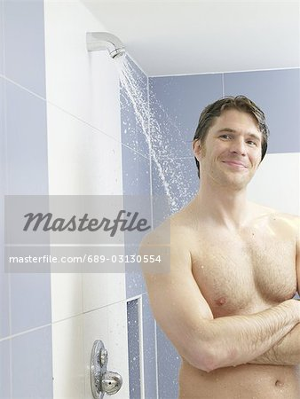 Man in the shower Stock Photo - Premium Royalty-Free, Image code: 689-03130554